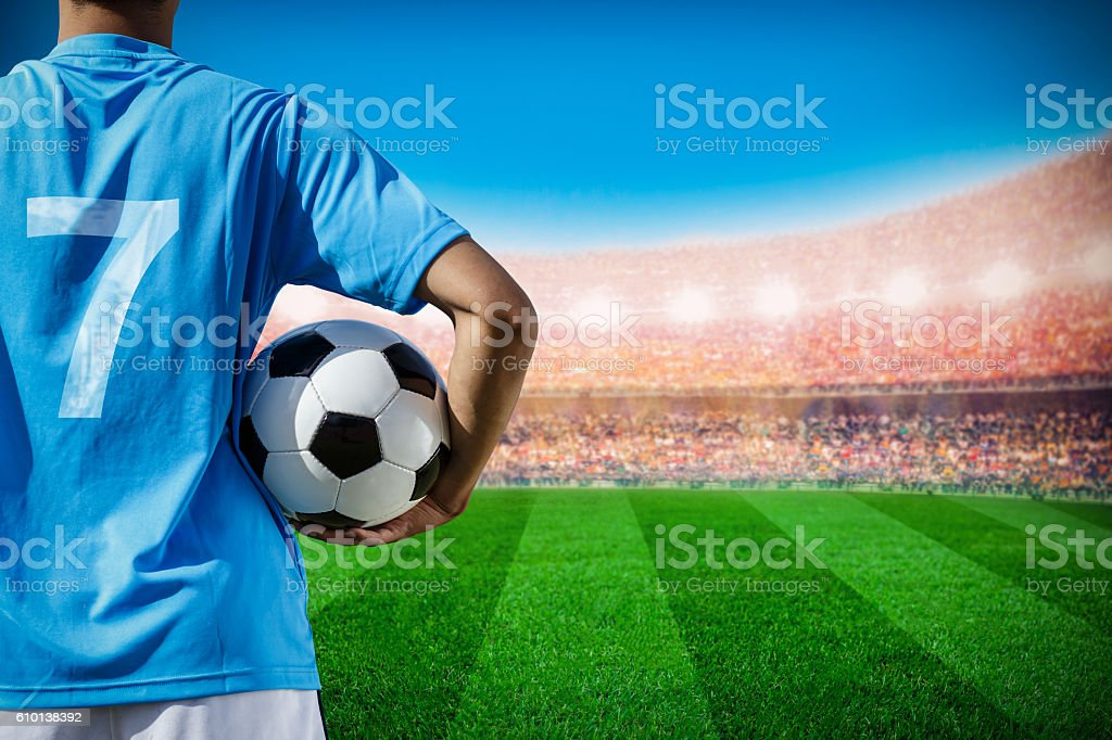 soccer football player no.7 in blue team concept holding soccer stock photo