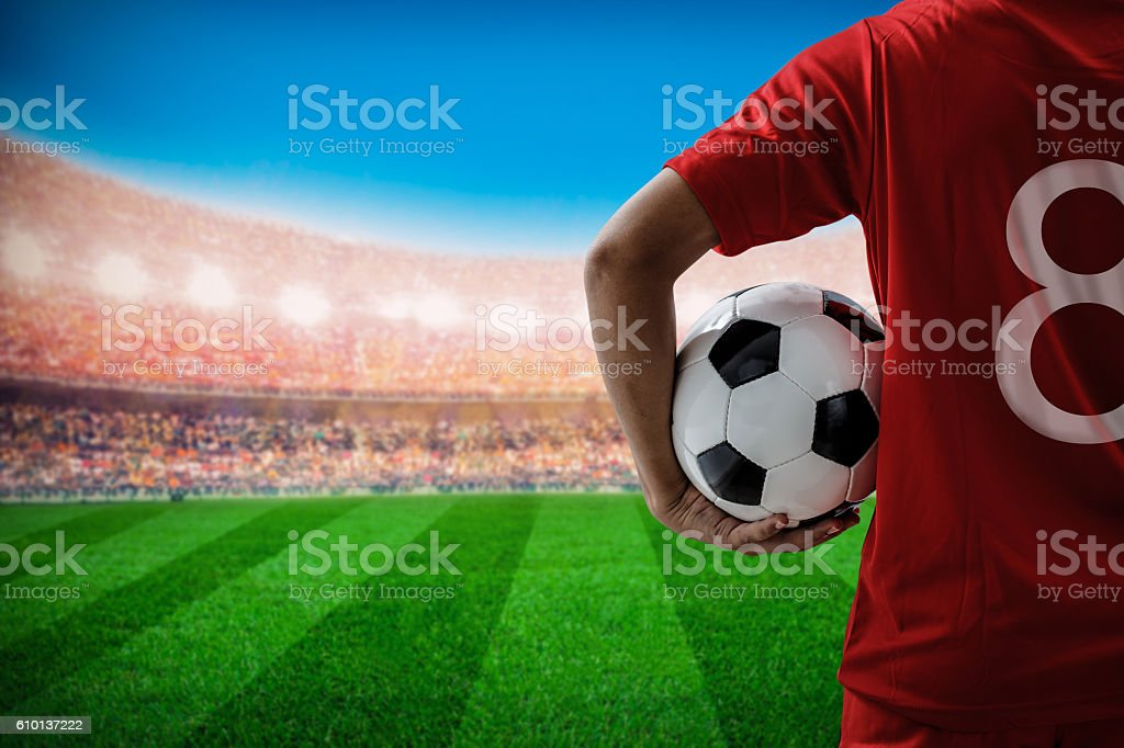soccer football player no.8 in red team concept holding ball stock photo
