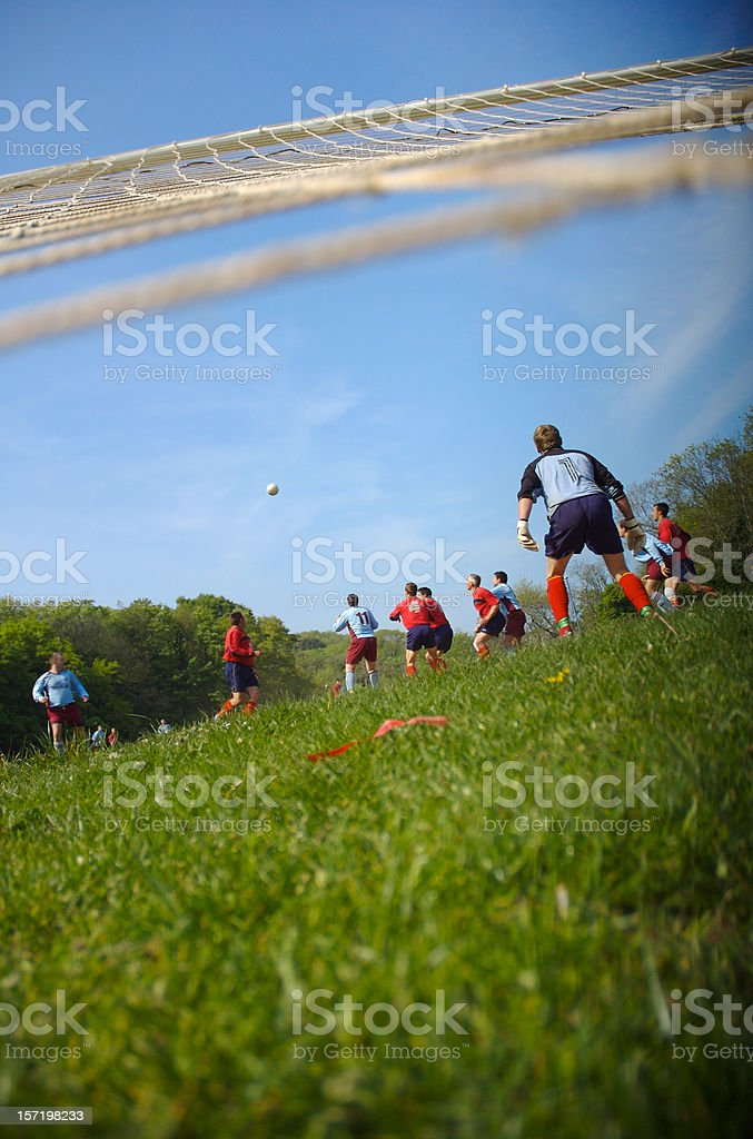 Soccer Football Team Viewed from the Goal stock photo