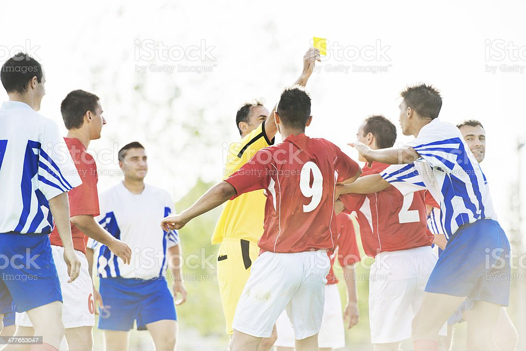 Soccer foul. stock photo