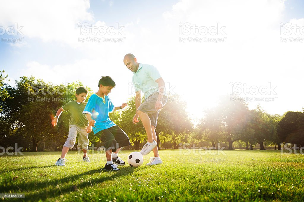 Soccer Fun Sports Family Playing Concept royalty-free stock photo