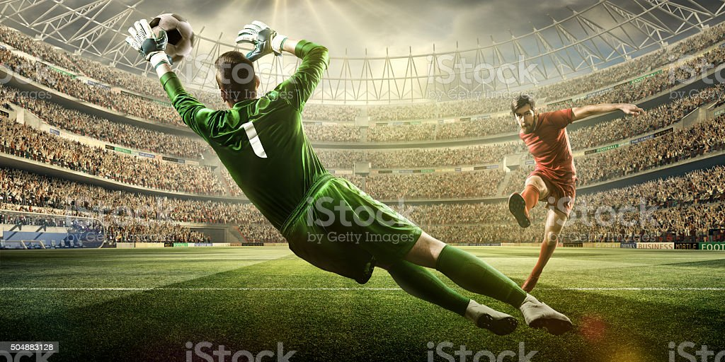 Soccer game moment with goalkeeper stock photo