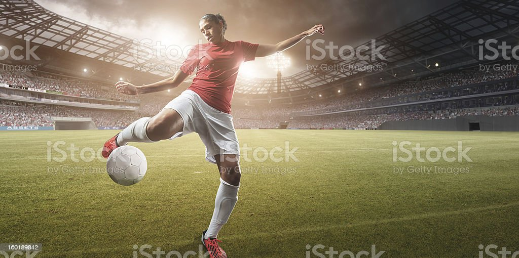 Soccer Girl About to Strike Football royalty-free stock photo