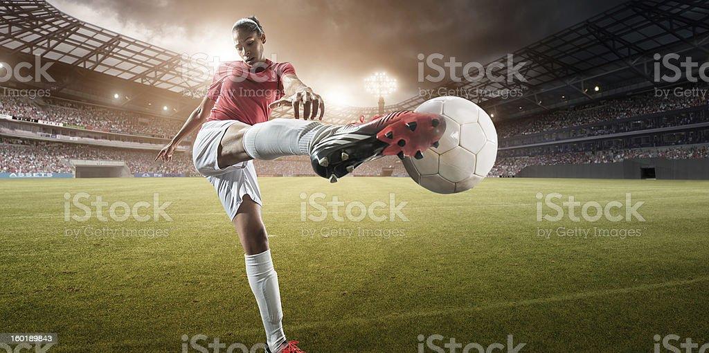 Soccer Girl Kicking Football royalty-free stock photo