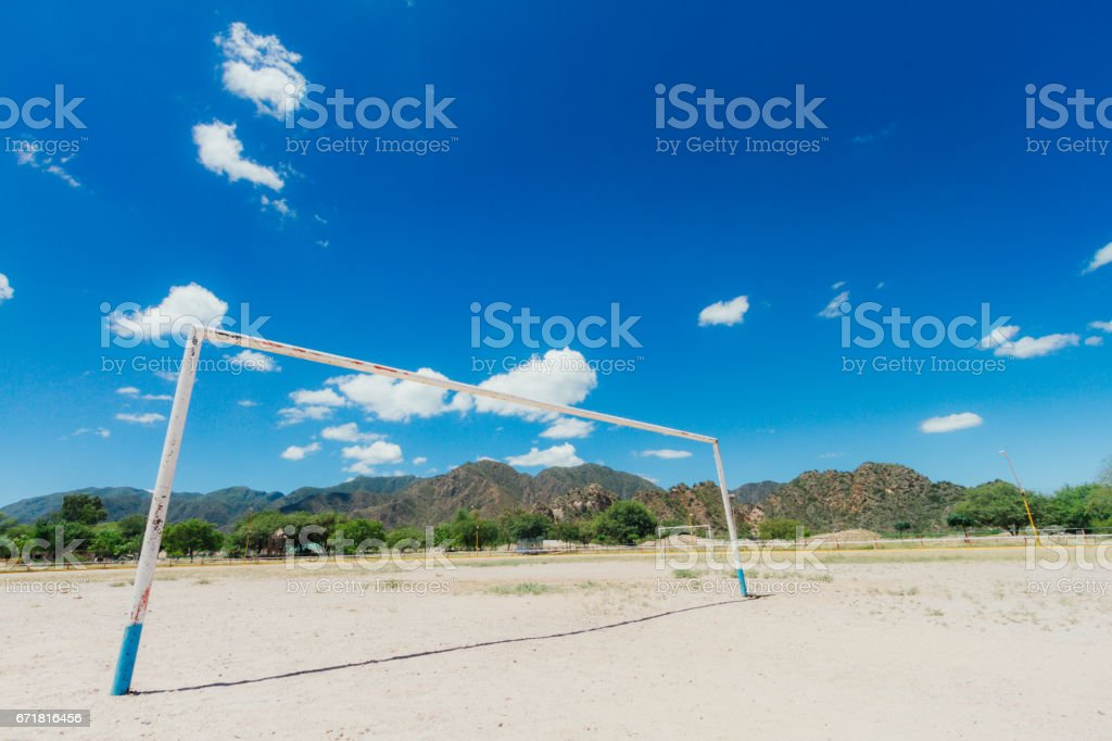 Soccer goal on a dirt field with hills in Catamarca stock photo