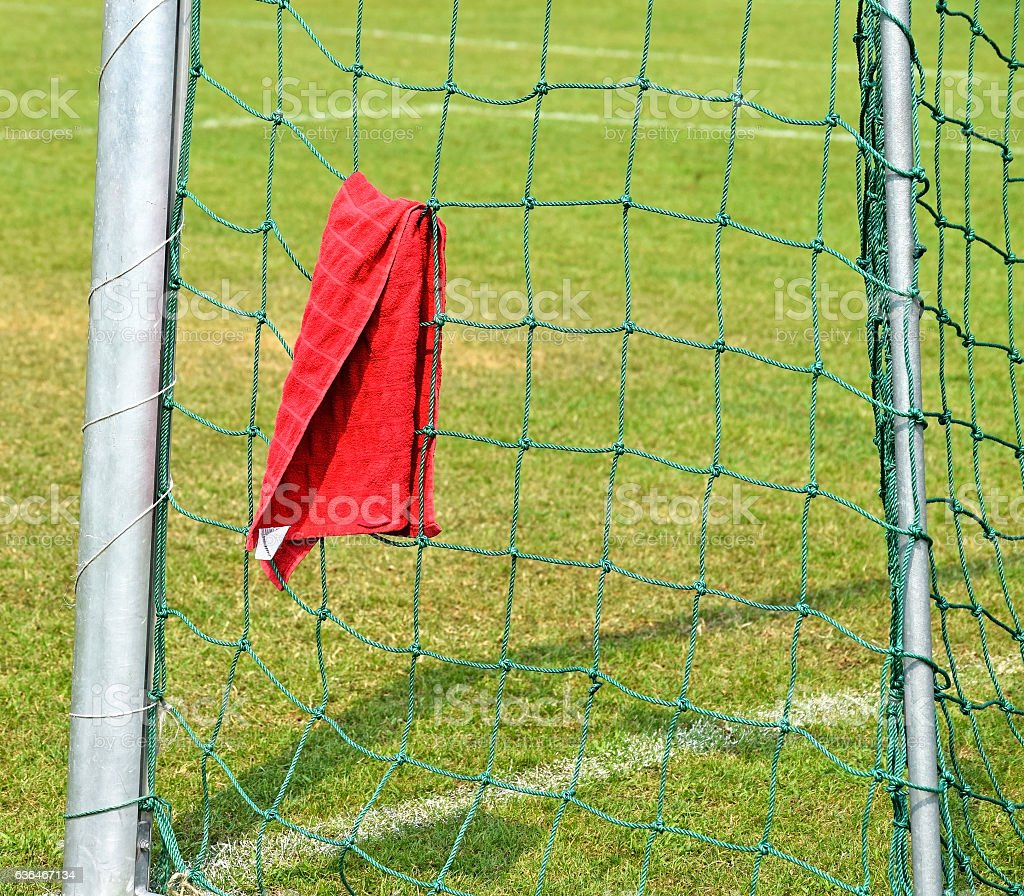 Soccer goal post and net with a towel on it stock photo