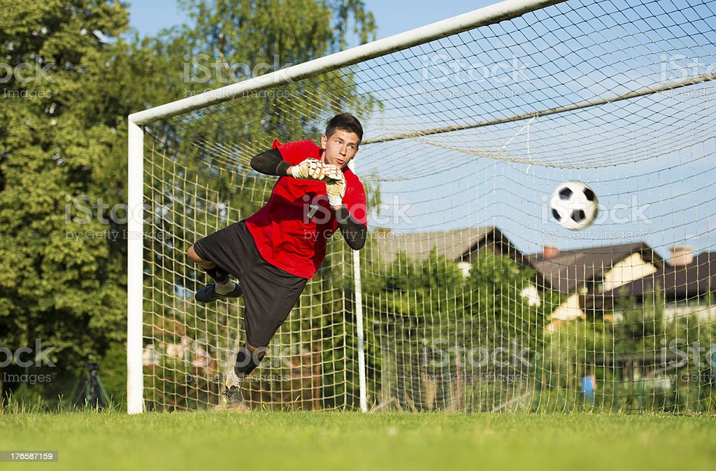 Soccer goalie defending in mid-air royalty-free stock photo