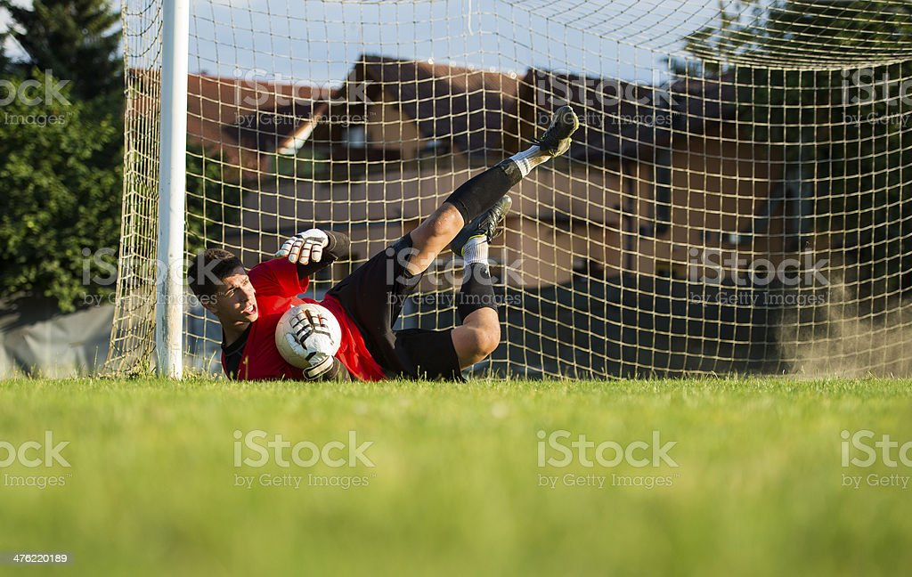 Soccer goalie in defending action royalty-free stock photo