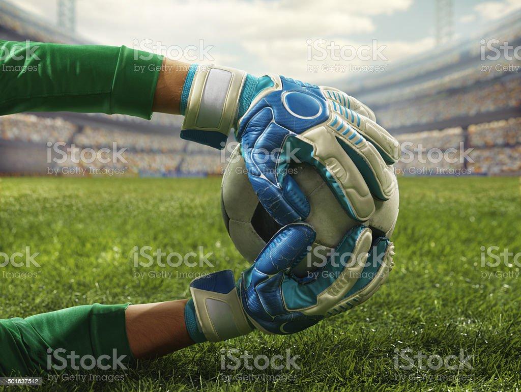 Soccer goalkeeper catches a ball stock photo