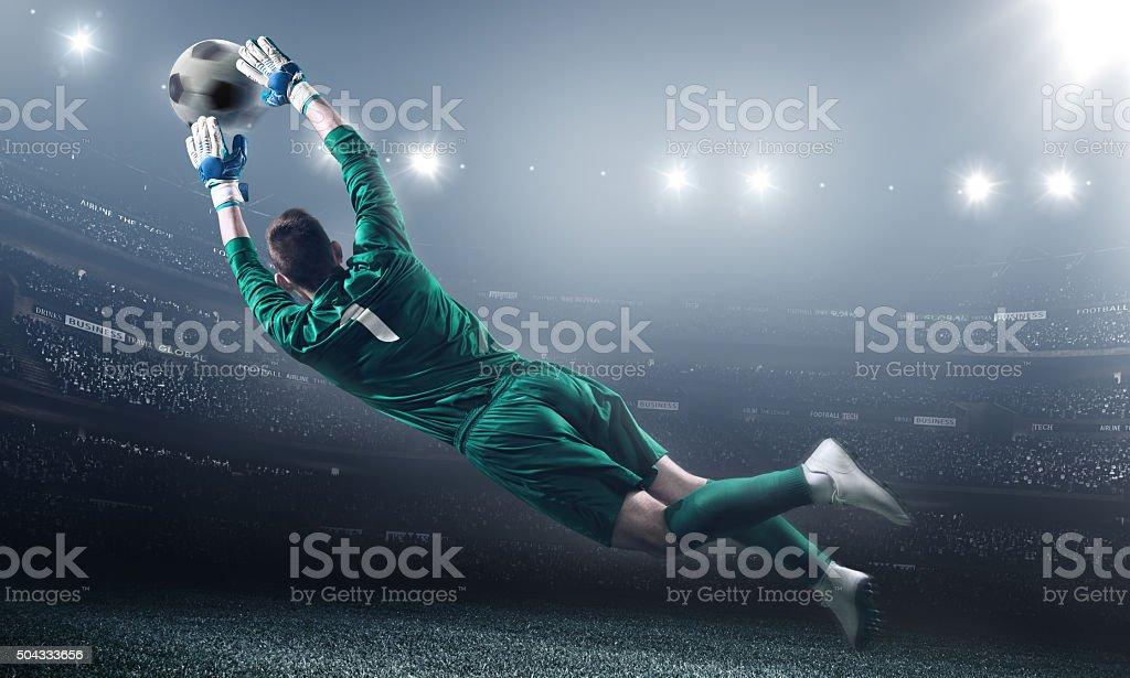 Soccer Goalkeeper in a jump stock photo