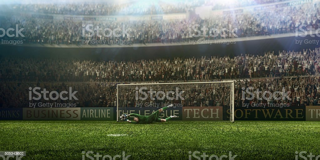 Soccer Goalkeeper in a jump stock photo