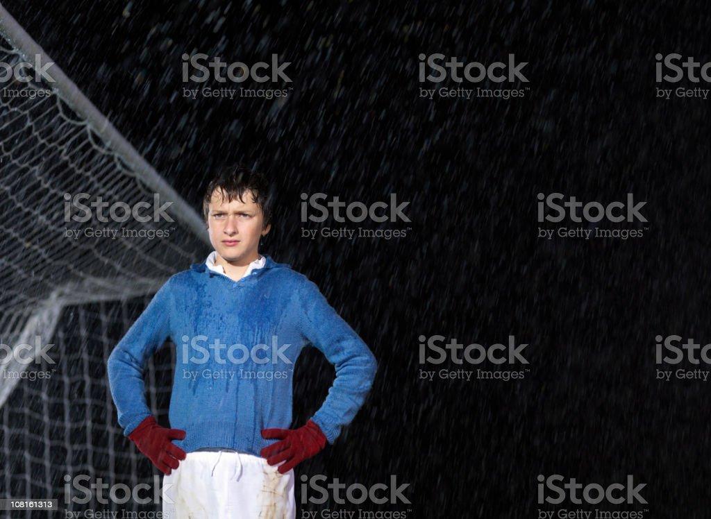 Soccer goalkeeper in rain at night royalty-free stock photo