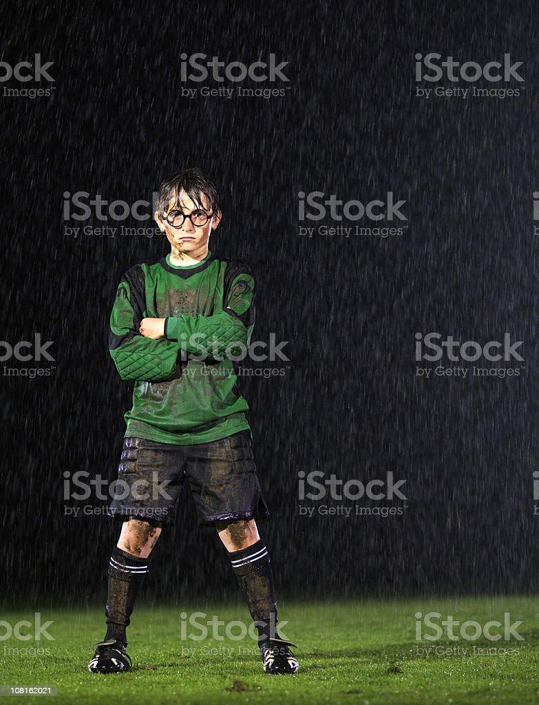 Soccer goalkeeper in the rain stock photo