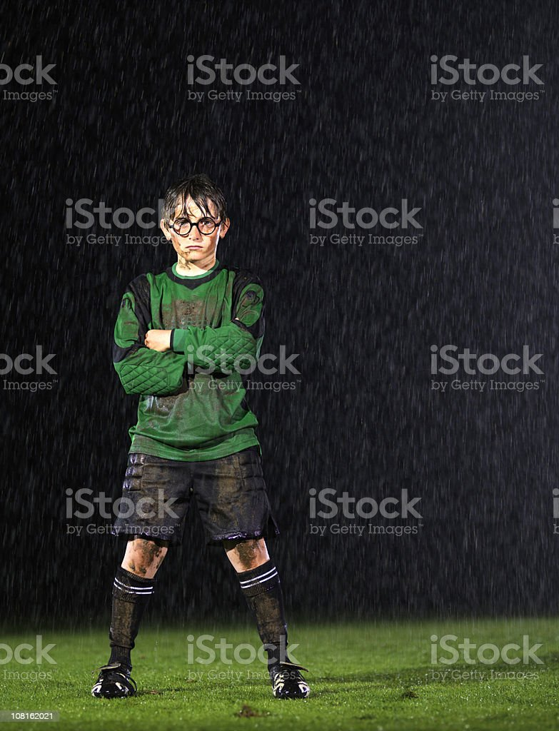 Soccer goalkeeper in the rain stock photo