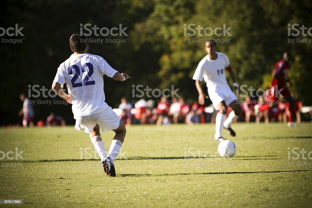 Soccer imagery with players in white uniforms stock photo