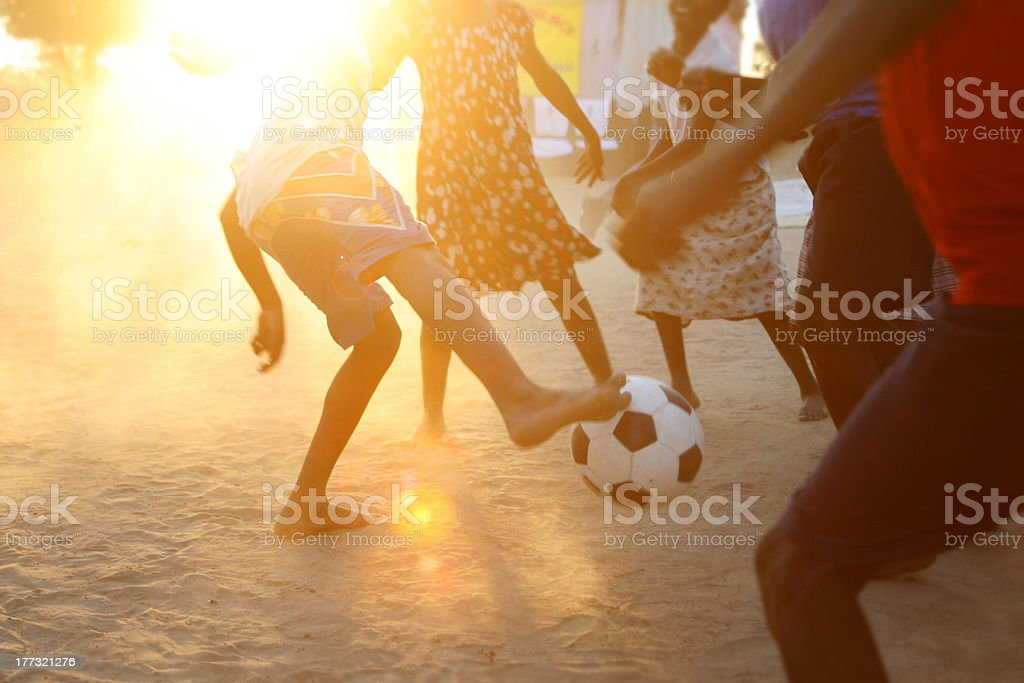 Soccer in the dirt stock photo