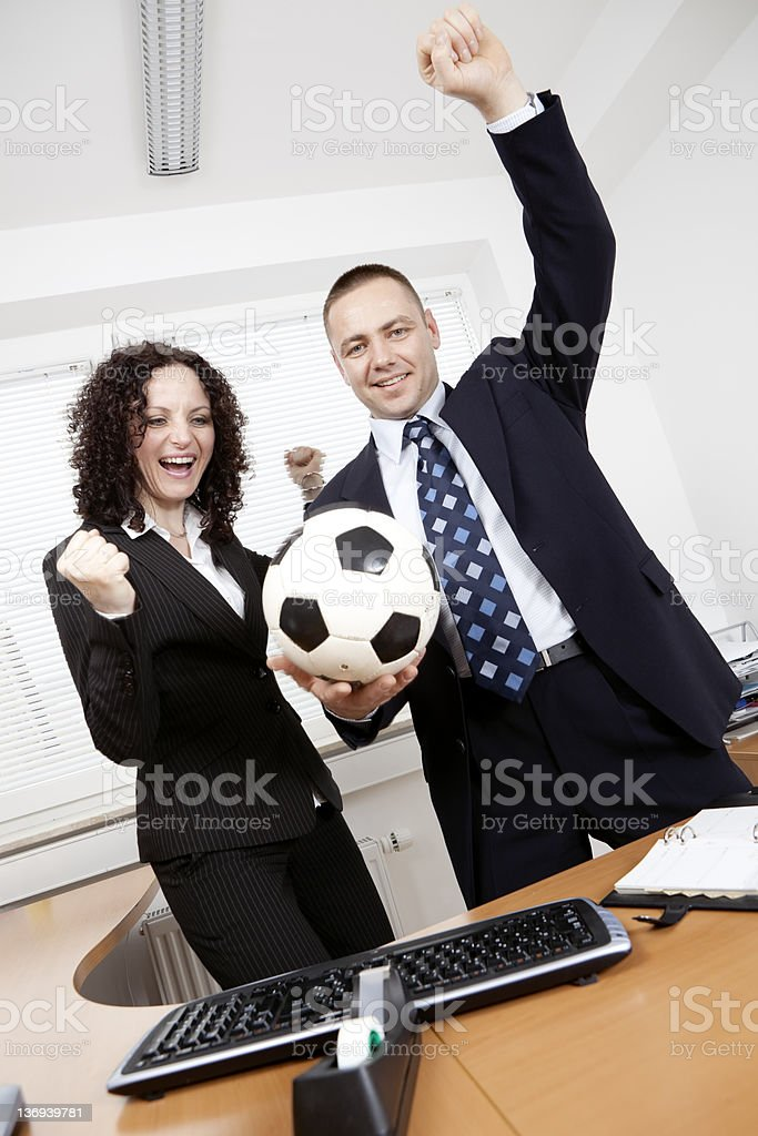 Soccer in the office stock photo
