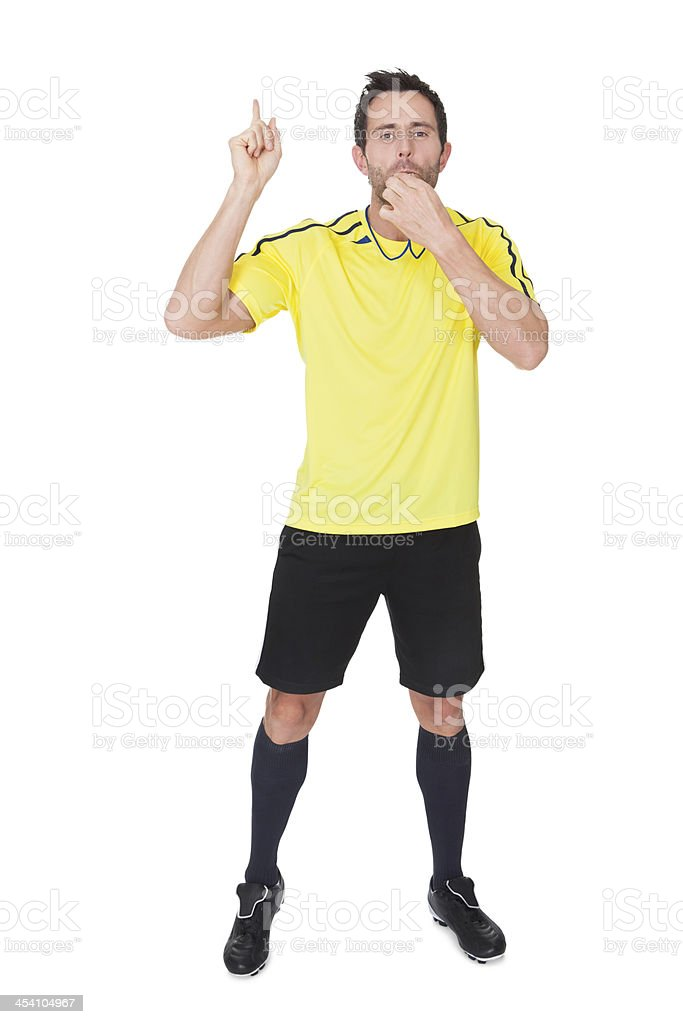 Soccer judge whistling royalty-free stock photo