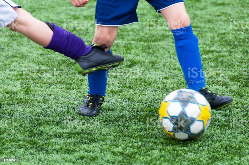 Soccer, kick on the knee stock photo