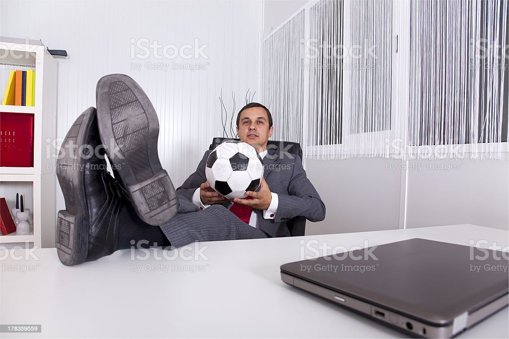 Soccer manager at the office stock photo