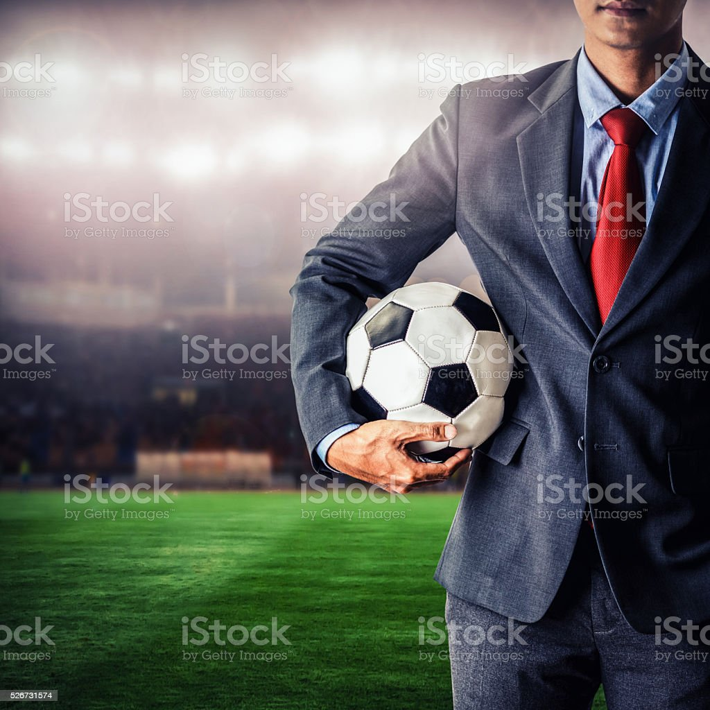 soccer manager holding football stock photo