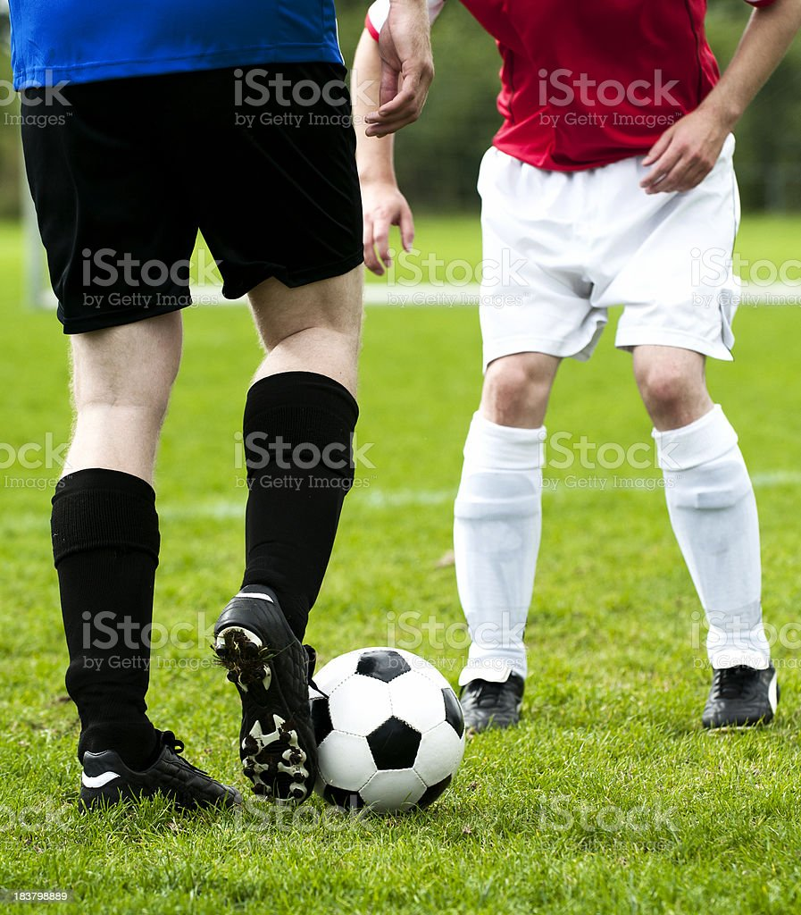 Soccer match with to players trying to outsmart each other royalty-free stock photo