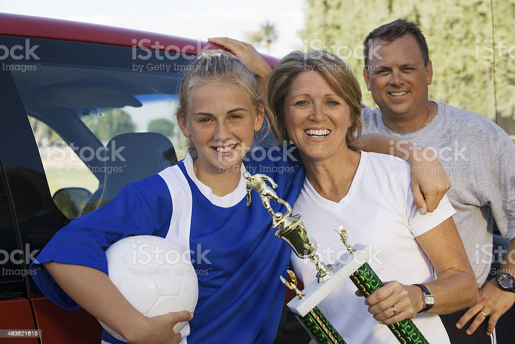 Soccer Mom with Daughter and Husband stock photo