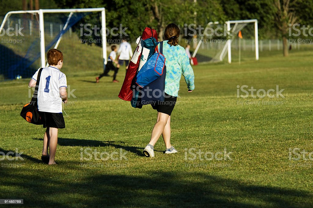 Soccer Mom with Son walking to Soccer Game stock photo