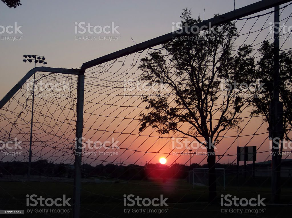 Soccer Net in Sports Park at Sunset stock photo