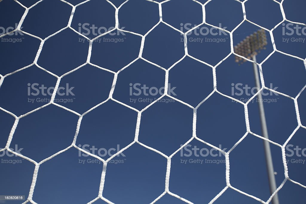 Soccer net on the field royalty-free stock photo