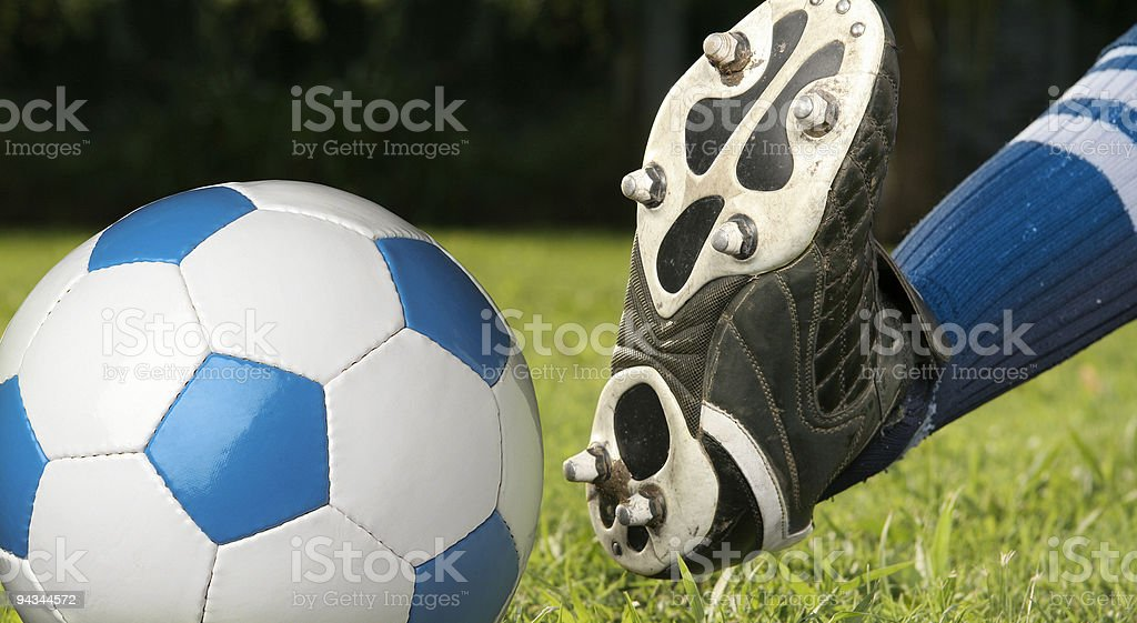 Soccer player about to kick ball royalty-free stock photo