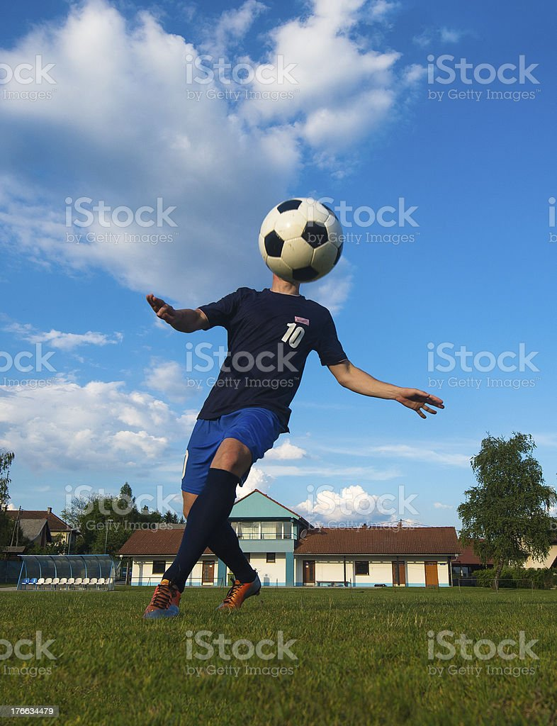 Soccer player against the blue sky royalty-free stock photo