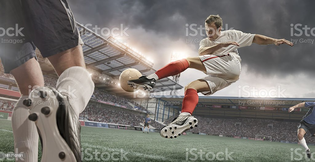 Soccer Player Amazing Mid Air Volley royalty-free stock photo