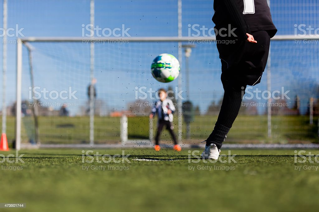 Soccer player and goalie during penalty shootout stock photo