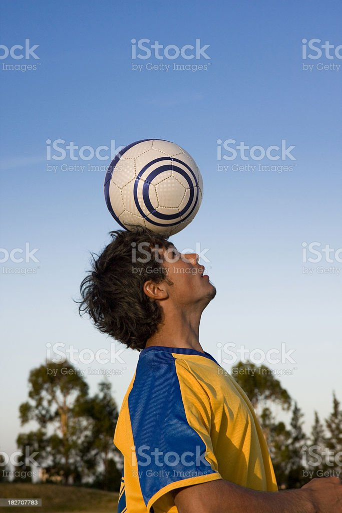 Soccer Player Balancing Ball on Head royalty-free stock photo