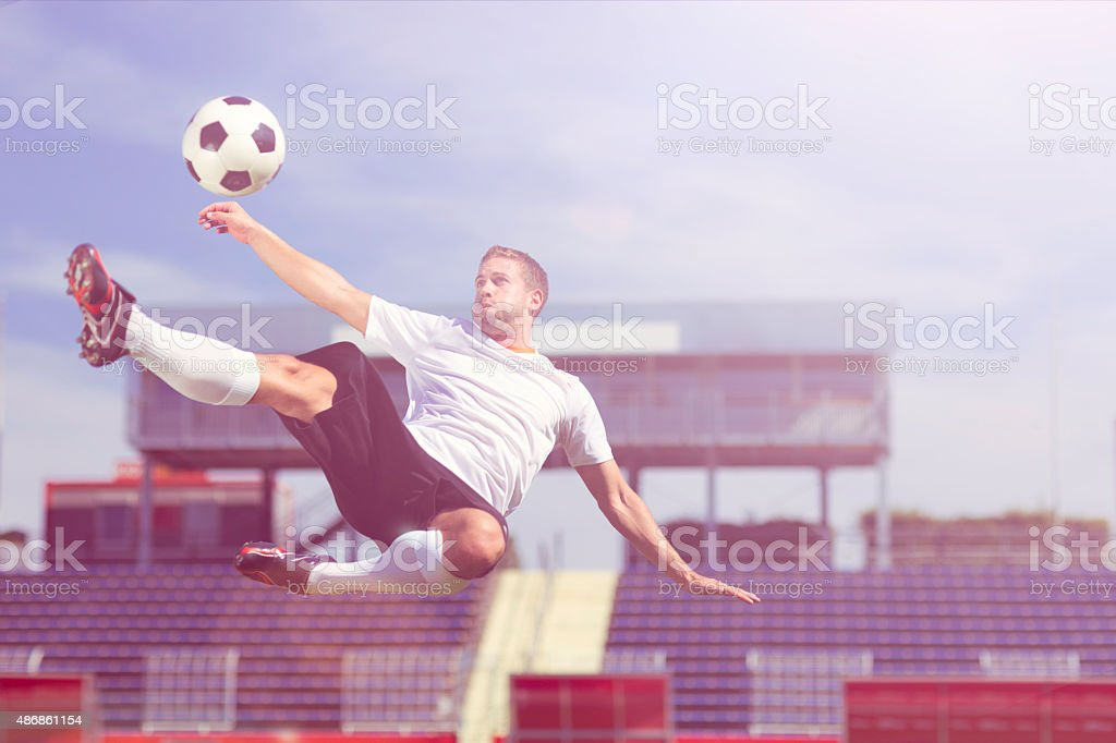 soccer player bicycle kick, modern stock photo