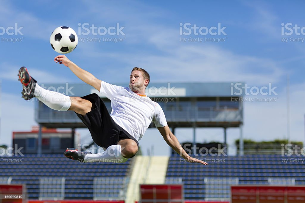 soccer player bicycle kick stock photo