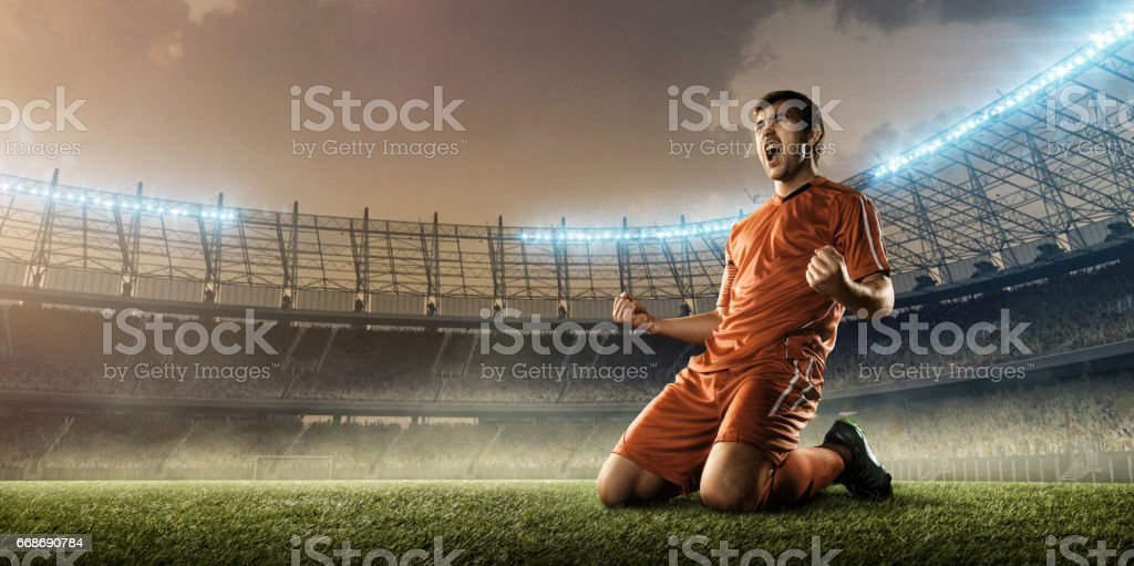 soccer player celebrating a victory stock photo