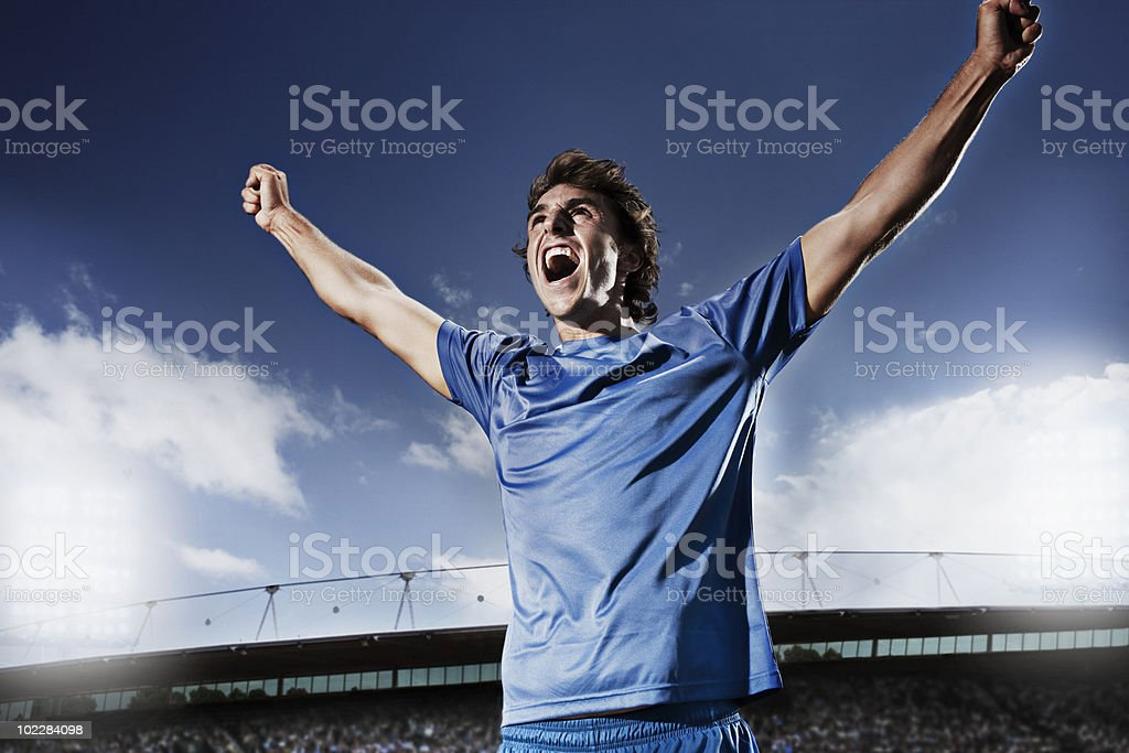 Soccer player cheering stock photo