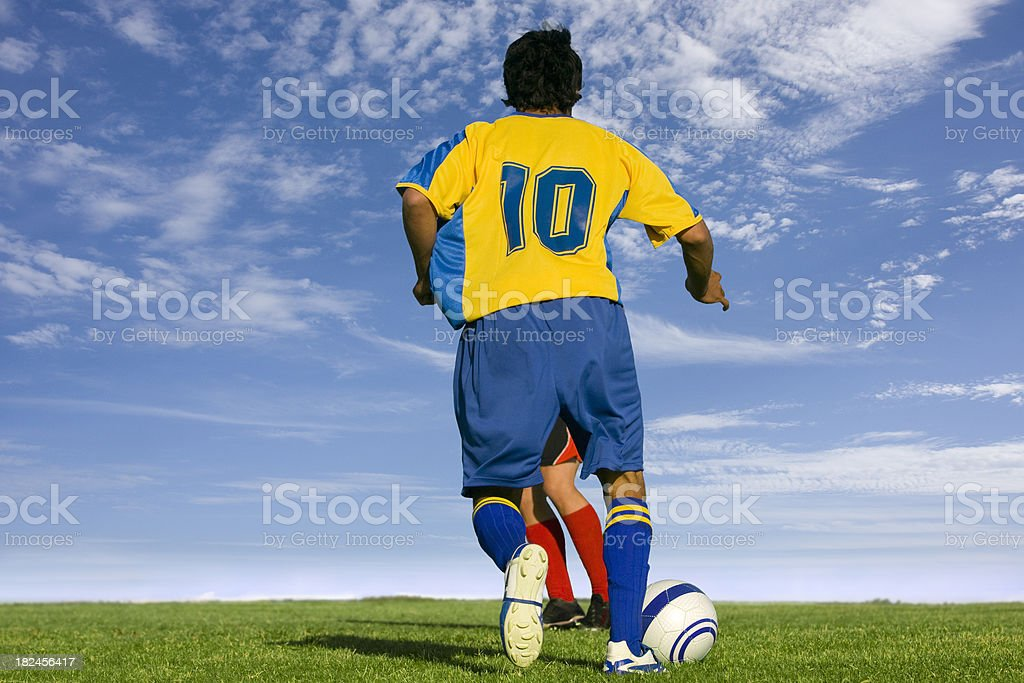 Soccer player dribbling royalty-free stock photo
