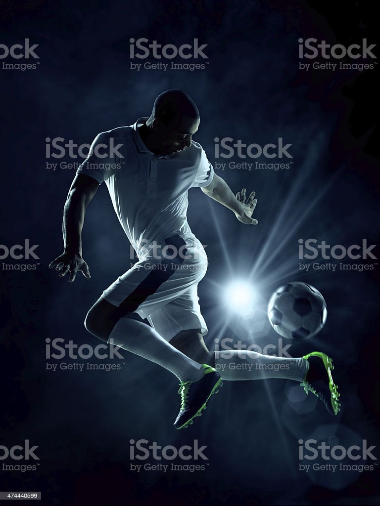 Soccer player dribblring a ball stock photo