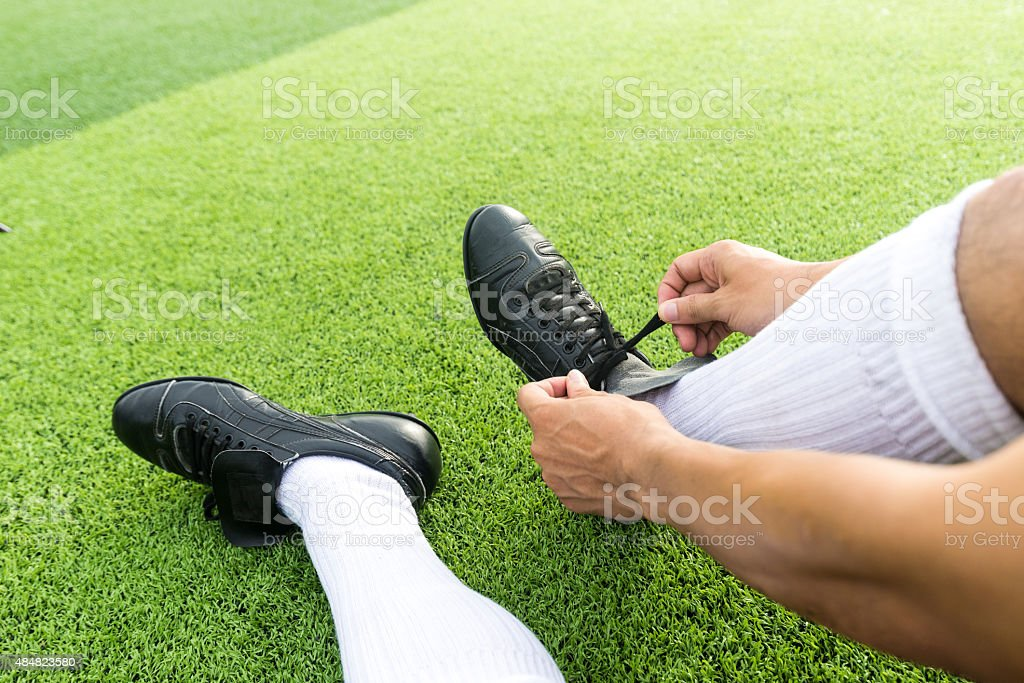 Soccer player getting ready for the game stock photo