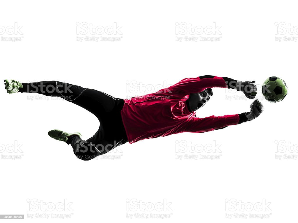 soccer player goalkeeper man punching ball silhouette stock photo
