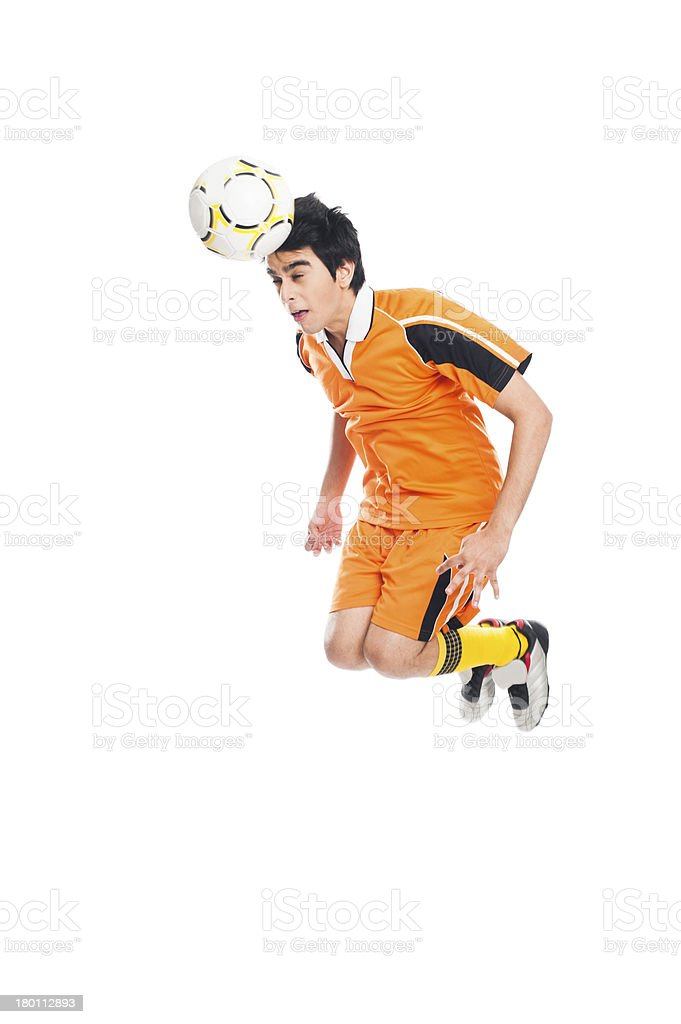 Soccer player heading a ball royalty-free stock photo