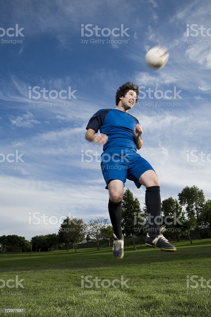 Soccer player heading ball royalty-free stock photo