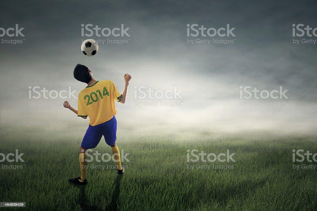 Soccer player heading ball royalty-free stock photo