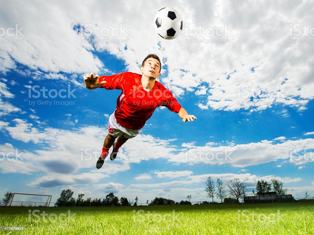 Soccer player heading the ball. stock photo