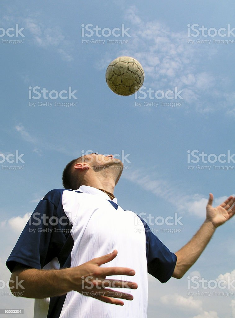 Soccer player heading the ball royalty-free stock photo
