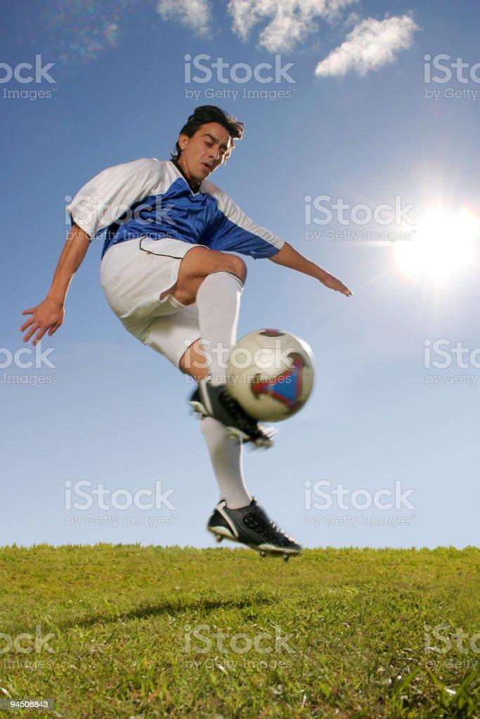 Soccer player hitting ball jumping royalty-free stock photo