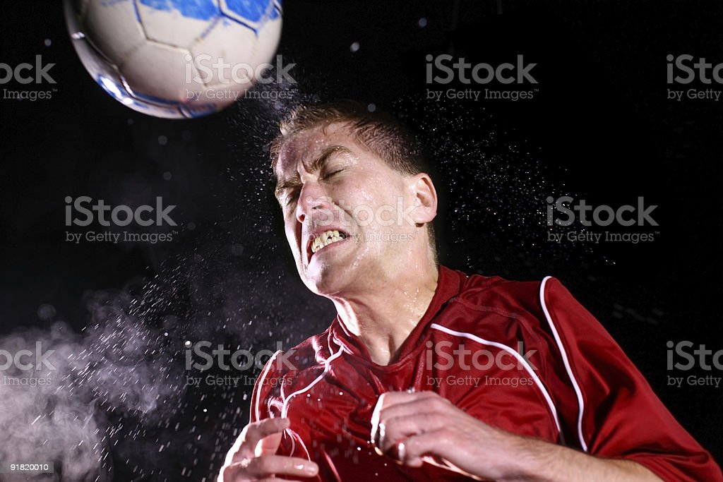 Soccer player hitting ball with head stock photo